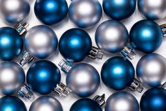 Pattern of blue and silver New Year and Cristmas balls. On white background royalty free stock image