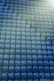 Pattern of blue steel seats in stadium. Rows / pattern of blue steel seats at football / soccer stadium with the ray of light Royalty Free Stock Photos