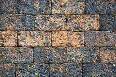 Pattern brown color of modern style design decorative uneven cracked real stone wall home surface with cement Royalty Free Stock Image