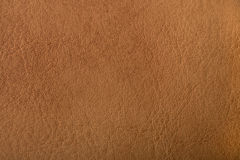 Pattern  brown leather pattern. Image for background from a fabric pattern Royalty Free Stock Photo