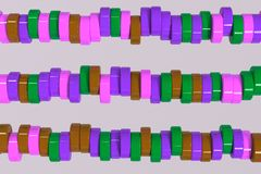 Pattern of brown, violet and green cylinder tablets on white bac. Kground. Plastic pucks. Abstract background. 3D rendering illustration Stock Photo