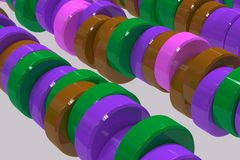 Pattern of brown, violet and green cylinder tablets on white bac. Kground. Plastic pucks. Abstract background. 3D rendering illustration Stock Image