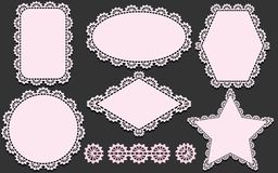 Pattern brush and set of napkins in different forms. Pink doilies elements isolated on gray background. Pattern brush and set of lace napkins in different forms Royalty Free Stock Image