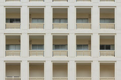Pattern Building. Many same windows on white building Royalty Free Stock Photos