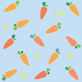 Pattern with carrots. On blue background Royalty Free Stock Photos