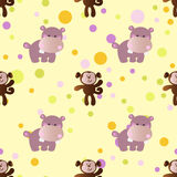 Pattern with cartoon cute baby behemoth and monkey. Seamless pattern with cartoon cute toy baby behemoth, monkey and Circles on a light yellow background Stock Photography