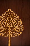 Pattern carve gold tree on wood texture Royalty Free Stock Photos