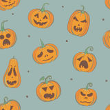Pattern with carved pumpkins. Vector seamless pattern with carved pumpkins on pale green background. Halloween wrapping paper design royalty free illustration