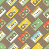 Pattern with cassettes - 2. Seamless Pattern with retro audiocassettes on brown background Stock Photos