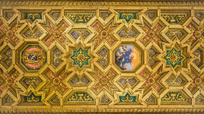 The pattern of the ceiling with a gold-painted statues of saints and icons in the Basilica of Santa Maria in Trastevere Royalty Free Stock Images