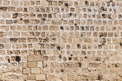 Pattern of cement stone block from castle wall with a lot of hole stock image