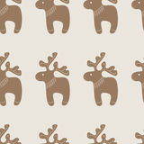 Pattern with Christmas reindeer cookie. Seamless pattern with Christmas decorated reindeer cookie on beige background Royalty Free Stock Image