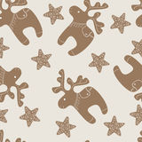 Pattern with Christmas reindeer and star cookies Royalty Free Stock Photo
