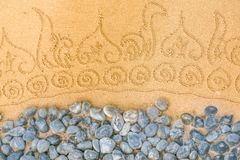 Pattern on clean sand with stones. The concept of peace and cont stock photography