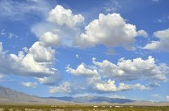Pattern of clouds over hills and mountain range in the Mojave Desert stock photos