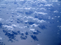 Pattern clouds over the ocean Stock Photos