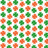 Pattern with clover. Seamless pattern with clover in a grunge style in the colors of the Irish flag Stock Images