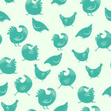 A pattern with cocks and chickens. Seamless pattern with cocks and chickens, On a green background Stock Photos