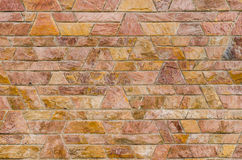 Pattern color of modern style design decorative red slate stone. Wall surface with cement in trapezoid shape Royalty Free Stock Photography