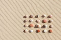 Pattern of colored pebbles on clean sand. Zen background, harmony and meditation concept. Pattern of colored pebbles on clean sand. The concept of peace and stock image