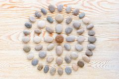 Pattern of colored pebbles on white wooden background. Flat lay, top view stock photos
