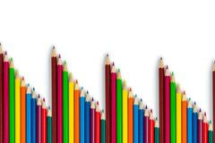 A pattern of colored pencils on a white background. Isolated items royalty free stock photos