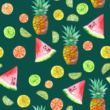 A pattern with the colored watercolor candied fruits, pineapple, lime and watermelon. A seamless pattern with the colored watercolor candied fruits, pineapple Royalty Free Stock Images