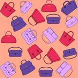 Pattern of colorful handbags on orange background. Pattern of colorful female handbags on the orange background Royalty Free Stock Image