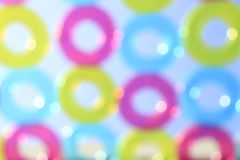 Pattern of colorful pool rings against blue sky - Defocus bokeh. For background Stock Images