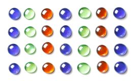 Pattern of colorful, shiny glass beads. Isolated on white. Spa b. Pattern of red, green and bluel, shiny glass beads. Isolated on white. Spa background, texture Royalty Free Stock Photography