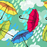 Pattern with colorful umbrellas. Vector seamless pattern with colorful umbrellas and clouds Stock Photo