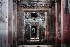 Pattern of columns, doorways in Angkor Wat. SIEM REAP, CAMBODIA: Receding pattern of interior arcade walls and columns within ancient temple at Angkor Wat Royalty Free Stock Photography