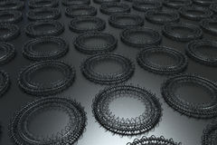 Pattern of concentric shapes made of rings and spirals on black. Background. Abstract geometric background with grid of concentric elements. 3D rendering Royalty Free Stock Photography