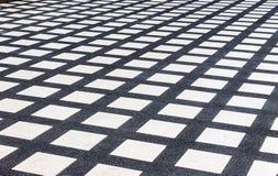Pattern concrete floor. White square pattern on black concrete floor Royalty Free Stock Photos