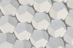 Pattern of concrete hexagonal elements. Wall of dodecahedrons. Architectural background. 3D rendering illustration Royalty Free Stock Image