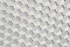 Pattern of concrete hexagonal elements. Wall of dodecahedrons. Architectural background. 3D rendering illustration Stock Photo