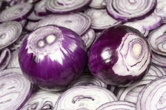 This pattern consists of sliced ​​red onion. This background consists of sliced ​​red onions Stock Image