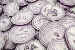 This pattern consists of sliced ​​red onion. This background consists of sliced ​​red onions Stock Photo