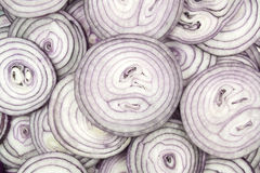 This pattern consists of sliced ​​red onion. This background consists of sliced ​​red onions Royalty Free Stock Images