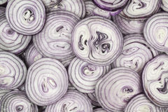 This pattern consists of sliced ​​red onion. This background consists of sliced ​​red onions Stock Images