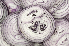 This pattern consists of sliced ​​red onion. This background consists of sliced ​​red onions Royalty Free Stock Photo
