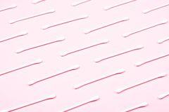 Pattern of cotton swabs on pink background. stock photos