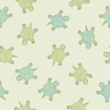Pattern with crawling little turtles. Seamless vector pattern, background with stylized hand drawn turtles Stock Photos