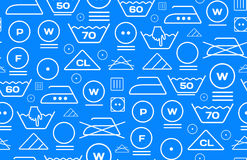 Pattern created from laundry washing symbols on a blue background Royalty Free Stock Photography