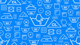 Pattern created from laundry washing symbols on a blue background Royalty Free Stock Images