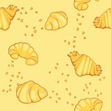 Pattern with croissants. On a yellow background Stock Photo