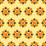 Pattern with crossed bones and paw prints Stock Photography