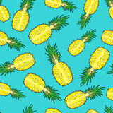 Pattern of cut pineapple. On a blue background. Seamless Stock Images