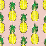 Pattern of cut pineapple. On a pink background. Royalty Free Stock Photo