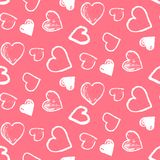Pattern with cute grunge white hearts on pink. Tender seamless pattern with cute grunge white scribbled hearts on pink background. Lovely doodle texture for St Royalty Free Stock Photography
